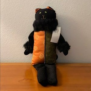 Wood and Poof musical plush black cat